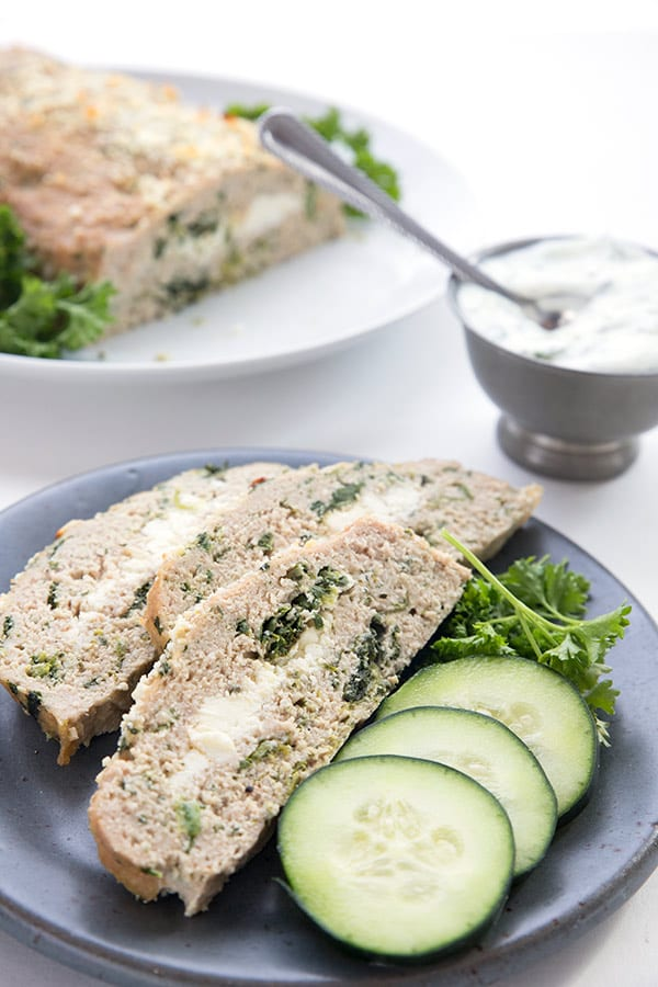 Slices of healthy turkey meatloaf with cucumbers