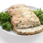 Healthy turkey meatloaf on a white plate with parsley