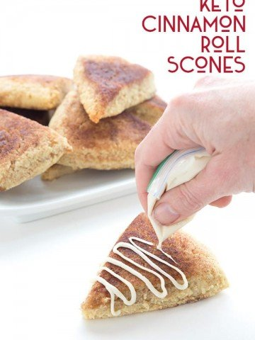 Drizzling sugar free cream cheese icing over keto cinnamon roll scones.