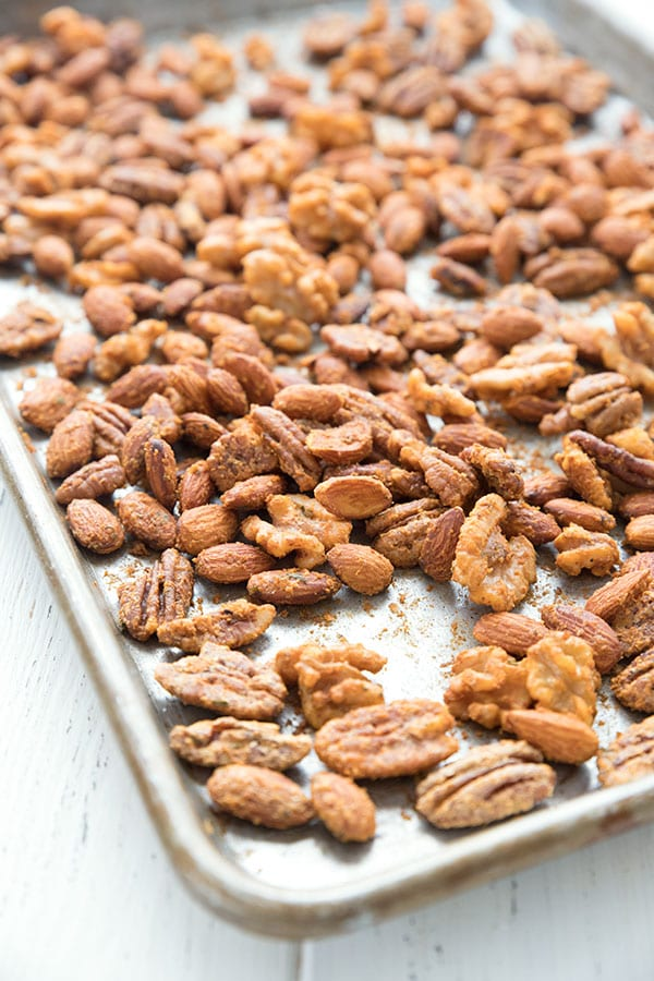 A pan full of Keto Buffalo Spiced Nuts on a white table