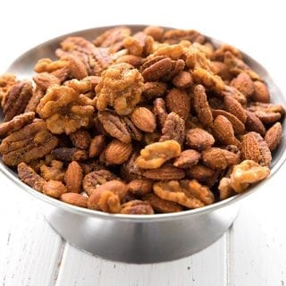A metal dish piled with keto buffalo spiced nuts
