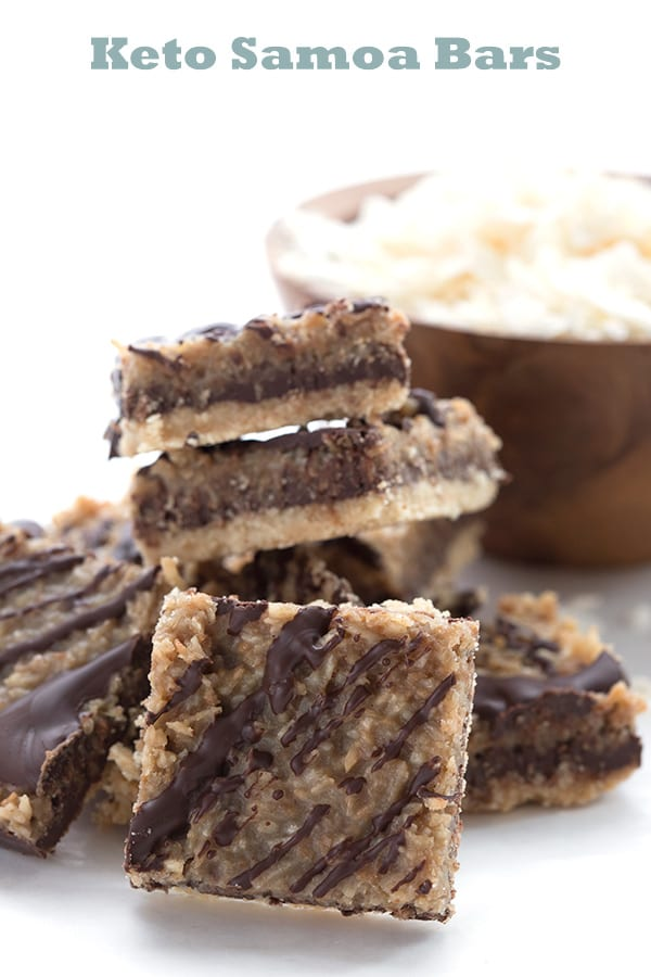 Easy Samoa Cookie Bars in a pile with shredded coconut