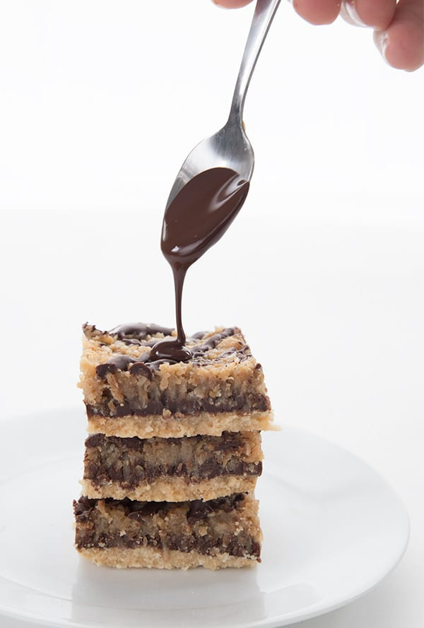 Drizzling chocolate over low carb Samoa Cookies