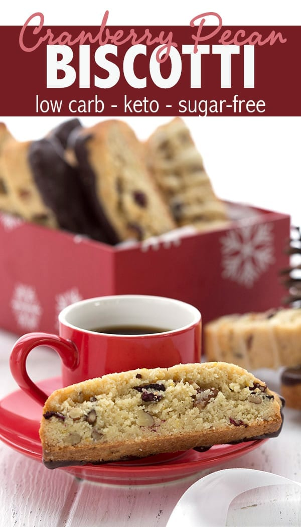 Easy keto almond flour biscotti studded with cranberries and pecans. Dipped in sugar free dark chocolate too! So delicious and a fun low carb holiday treat. Give as gifts or keep it ALLLLL to yourself. #ketorecipes #ketocookies #lowcardiet #lowcarbhighfat #keto #ketodiet #sugarfree #cranberries #biscotti