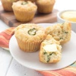 Cheddar Jalapeno Muffins with butter slathered on them.