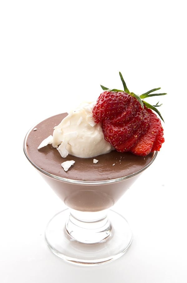 Coconut milk pudding with whipped coconut cream and a strawberry