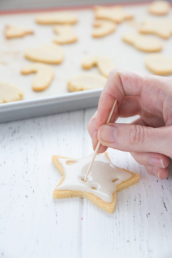 Flooding cut out sugar cookies with royal icing.