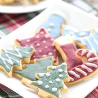 A plate full of low carb holiday sugar cookies on a green and red plaid napkin.
