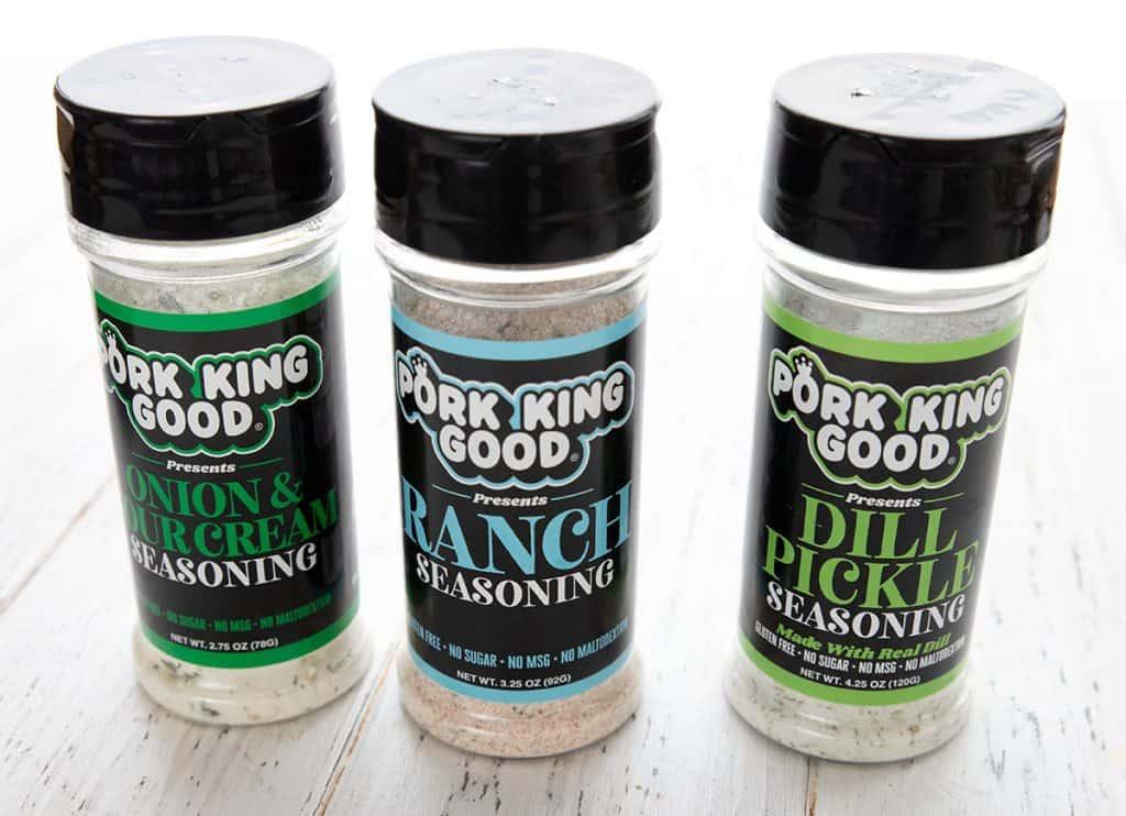 3 shaker jars of keto friendly seasonings on a white table.