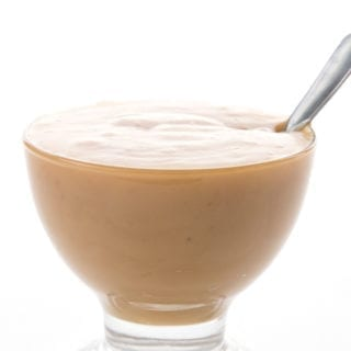 Sugar Free Dulce De Leche in a glass bowl with a spoon