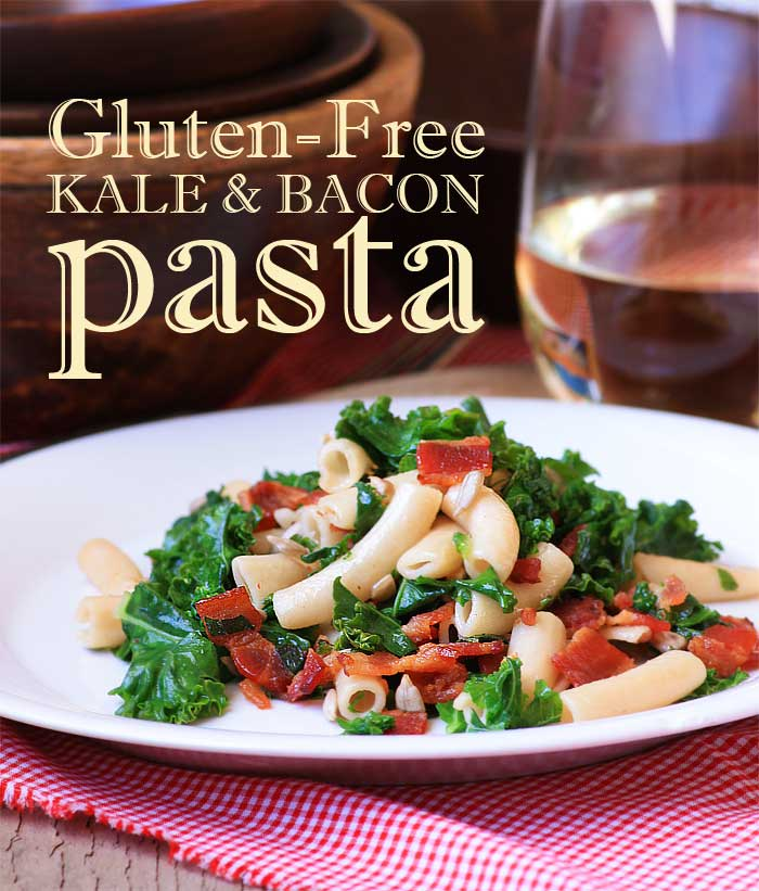 white plate of gluten-free kale and bacon pasta