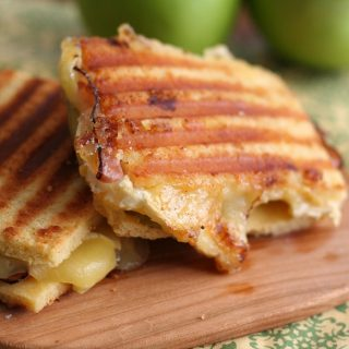 low carb flatbread panini sandwich with ham, green apple, and brie cheese