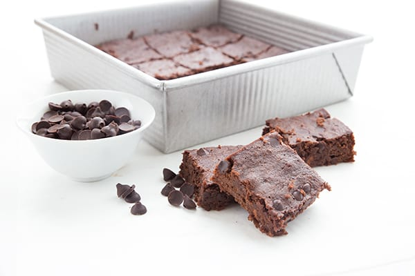 Low carb chocolate chips with keto brownies in a pan