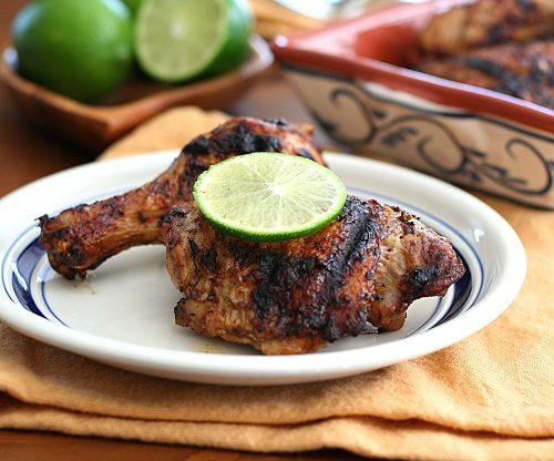 a platter of grilled chicken pieces flavored with chipotle seasoning and lime