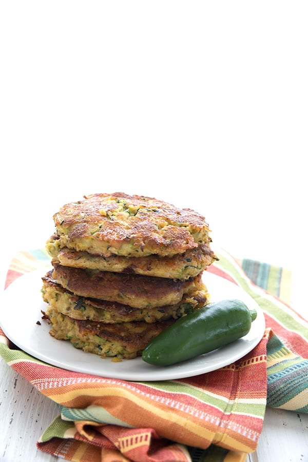 Cheddar Jalapeno Zucchini Fritters with a colorful stripped napkin
