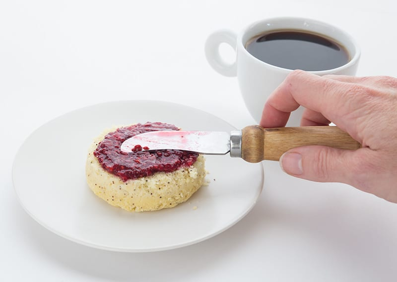 Sugar Free Jam being spread over a low carb muffin