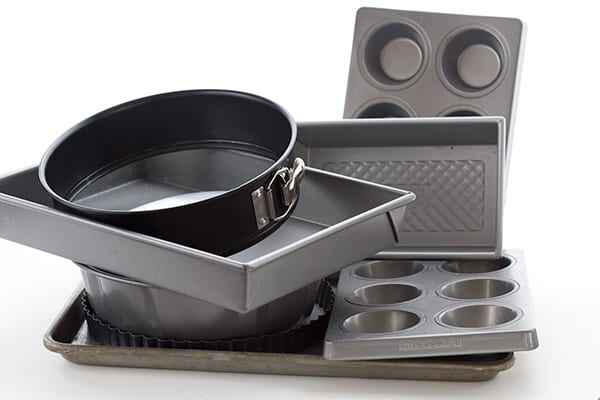 Photo of a collection of bakeware stacked on each other.