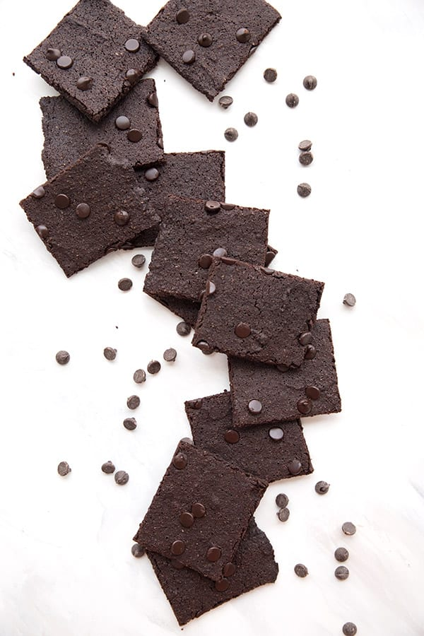 Top down photo of pieces of keto brownie bark on a white table