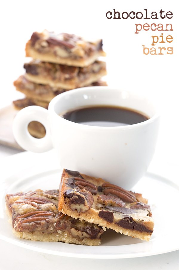 titled photo (and shown) chocolate pecan pie bars (on a plate, sitting next to a cup of coffee)