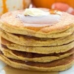 Close up photo of coconut flour pumpkin pancakes with butter and syrup