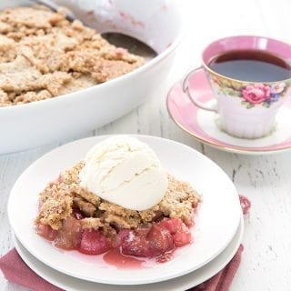 A serving of sugar-free rhubarb crisp with a cup of coffee