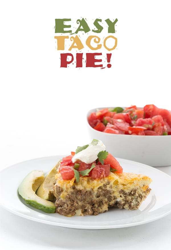 Low Carb Taco Pie - a slice on a plate with salsa behind.