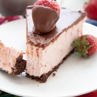 Close up shot of a slice of keto strawberry cheesecake
