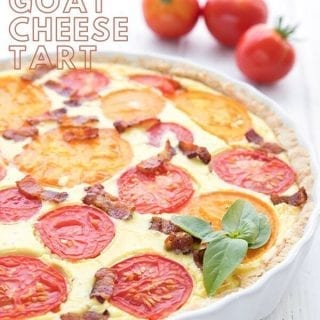 Titled image of goat cheese tart with tomatoes and bacon, in a white tart pan.