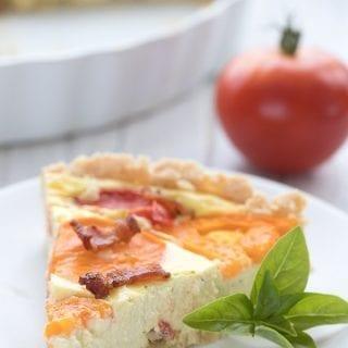 Close up shot of a slice of keto goat cheese tart