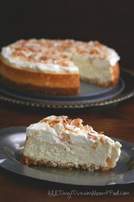 slice of sugar-free and gluten-free coconut cheesecake with macadamia nut crust