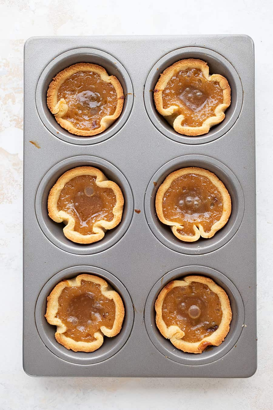 Top down image of keto butter tarts in the baking pan.