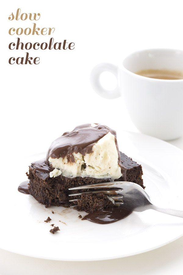 titled image: Slow Cooker Chocolate Cake - shown: a slice of keto chocolate cake topped with vanilla ice cream