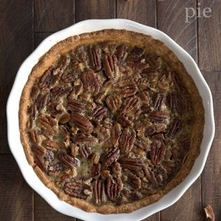 Top down photo of sugar free pecan pie on a brown wooden table