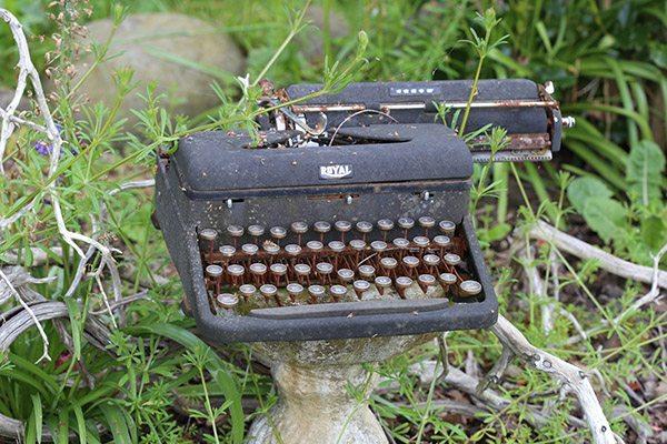 Old typewriter in garden