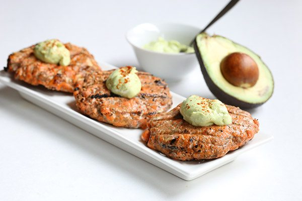 Healthy low carb salmon burgers with avocado cream sauce