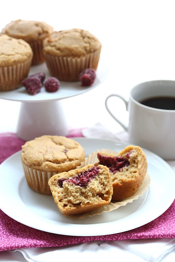 Low carb peanut butter muffins stuffed with delicious sugar-free raspberry chia seed jam. Perhaps the best keto breakfast you'll ever have.