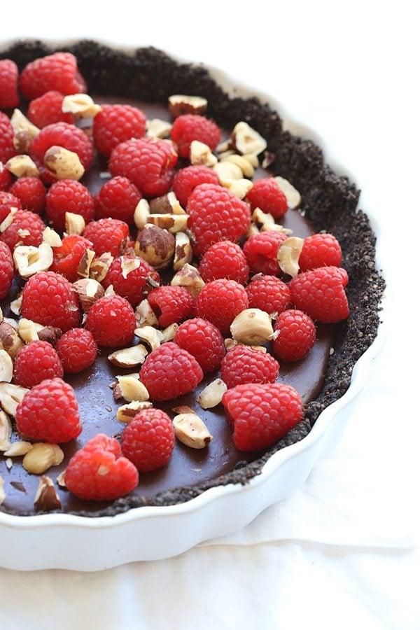 Creamy chocolate hazelnut ganache in a no-bake hazelnut flour crust. Low carb and grain-free.