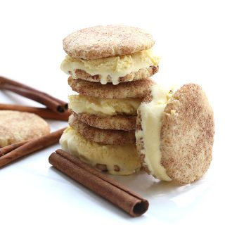 A stack of ice cream sandwiches with cinnamon sticks on a white background