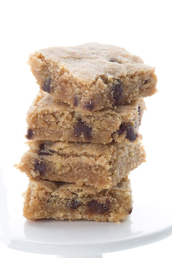 Stack of low carb almond flour blondies on a white plate