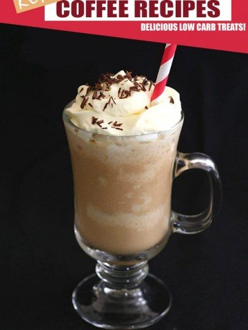 Keto Caramel Frappuccino in a clear glass on a black background. A red striped straw in the top.