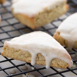 Close up of keto vanilla bean scones on a baking rack