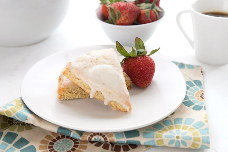 Low carb scones on a white plate with strawberries