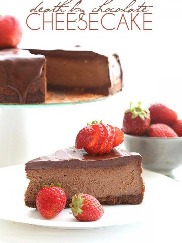 slice of Death By Chocolate Low Carb Chocolate Cheesecake topped with fresh strawberries