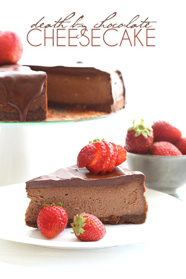titled image - Death by Chocolate Cheesecake - image shows a slice of keto chocolate cheesecake topped with strawberry slices