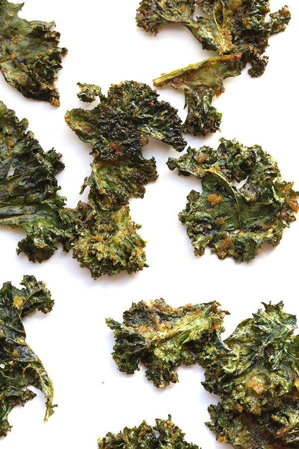 Think kale chips are boring? Try these vegan nacho kale chips with nutritional yeast. A great low carb snack!