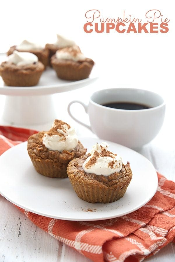 Keto Pumpkin Pie Cupcakes on a white plate with an orange napkin and more cupcakes in the background