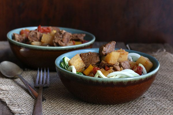 Low carb paleo Hungarian Goulash made with daikon radish and served over zucchini noodles