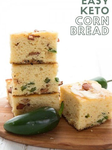Titled image of a stack of keto cornbread on a wooden cutting board