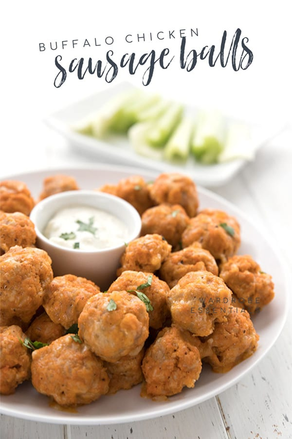 A plate of keto sausage balls with ranch dipping sauce in the center.