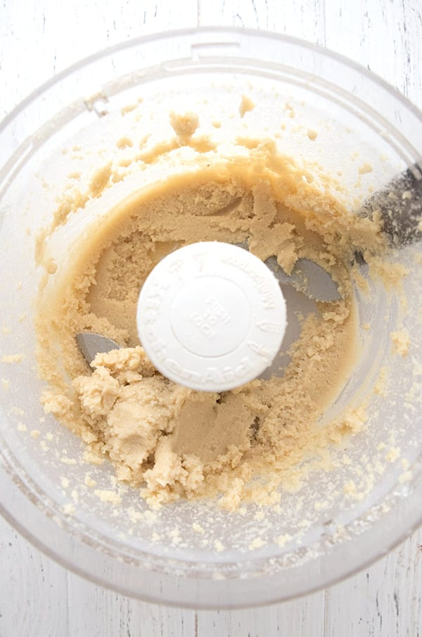 Top down photo of keto marzipan in a food processor